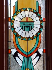 Stained glass window with Native American design.