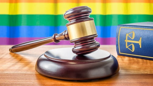 Gavel and a law book - Rainbow flag