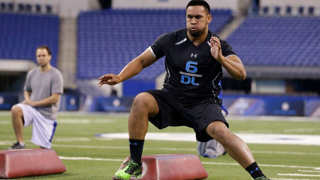 Oregon State defensive lineman Scott Crichton runs a drill at the NFL football scouting combine in Indianapolis Feb. 24.