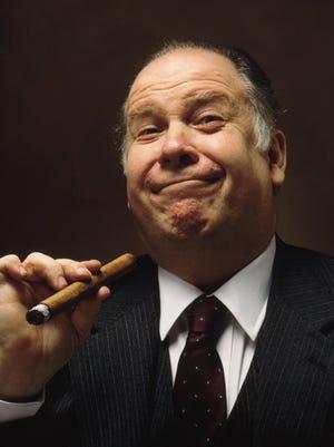 Stock, smug executive posing with cigar: is he REALLY worth 350 times what you make?