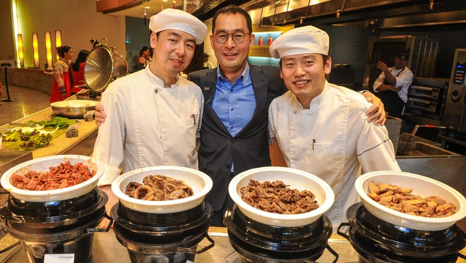 With variations of meat bulgogi in the foreground, Westin Resort Guam General Manager Harrison Cho, center, is photographed with guest chefs Chase Kim, left, and Dave Yun at the TASTE restaurant in Tumon on Tuesday, April 12. The venue will feature a Korean lunch buffet, prepared by Kim and Yun, until Saturday, April 16.