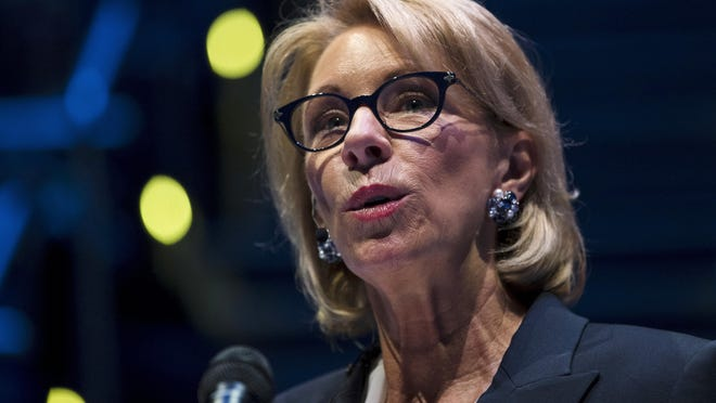 In this Sept. 17, 2018 photo, Education Secretary Betsy DeVos speaks during a student town hall at National Constitution Center in Philadelphia. Education Secretary Betsy DeVos is proposing a major overhaul to the way colleges handle complaints of sexual misconduct. The Education Department released a plan Friday that would require schools to investigate sexual assault and harassment only if it was reported to certain campus officials and only if it occurred on campus or other areas overseen by the school.