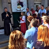 Although they could not partake in a communion without a priest present, worshipers held a prayer service outside the recently closed St. Joseph's Church.