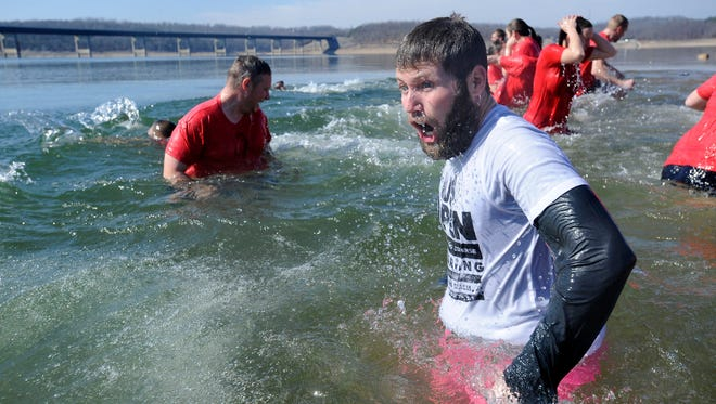 Polar plungers react to a chilly Norfork Lake in this file photograph from a past Polar Plunge. This year's Polar Plunge, which benefits Special Olympics, is set for 11 a.m. Saturday at Henderson Beach. Registration begins at 10 a.m.