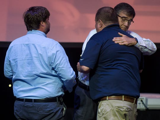 News Sentinel photographer Michael Patrick, center, thanks Dollywood employees Jordan Leach, left, and Evan Schukman, right, for saving his life in March during a ceremony honoring the employees for their heroic efforts on Wednesday, May 24, 2017.