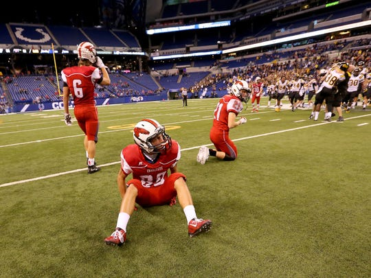 New Palestine players react after their comeback attempt falls short in last year's state title game.