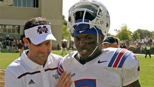 Mississippi State defensive coordinator Manny Diaz, left speaks with Louisiana Tech safety Xavier Woods (7) after their NCAA college football game in Starkville, Miss., Saturday, Oct. 17, 2015. (AP Photo/Jim Lytle)