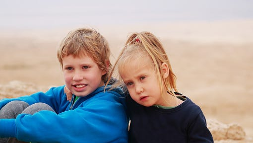 Stock image, portrait of a girl with her autistic brother