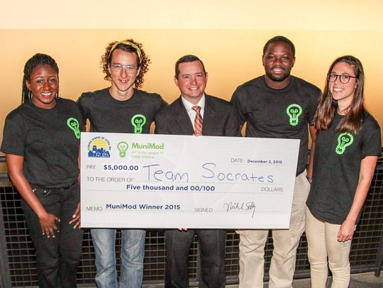Team Socrates was presented with the $5,000 reward