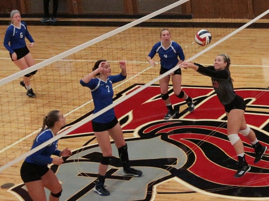 Reilly Hack sets the ball for Kentucky Christian in a game.