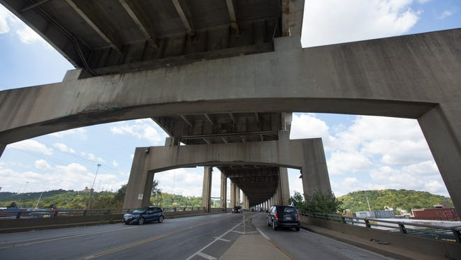 A view of the Western Hills Viaduct looking west. The viaduct was opened in 1932 to connect the West Side to downtown. Today, it's considered structurally deficit and must be replaced. The cost is $335 million. In the past few years, concrete meant to protect steel beams has crumbled and hit vehicles.
