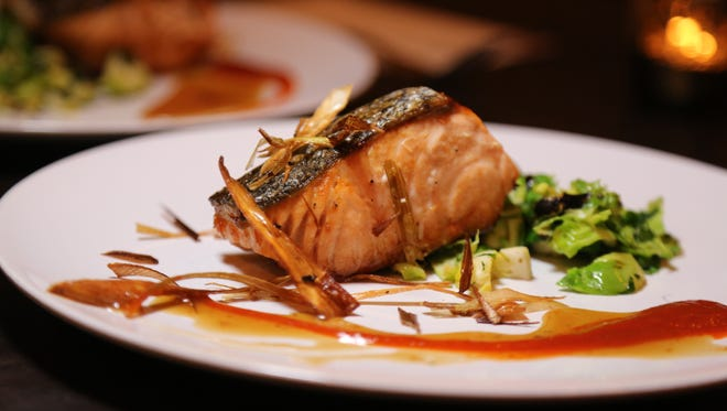 Jerk salmon with Brussels sprouts from Max Hardy's River Bistro restaurant in northwest Detroit.