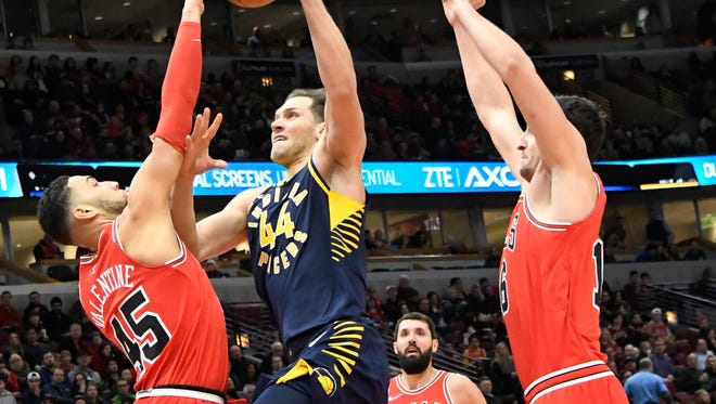 Dec 29, 2017; Chicago, IL, USA; Chicago Bulls forward Denzel Valentine (45) defends as Indiana Pacers forward Bojan Bogdanovic (44) shoots the ball during the first half at United Center. Mandatory Credit: David Banks-USA TODAY Sports