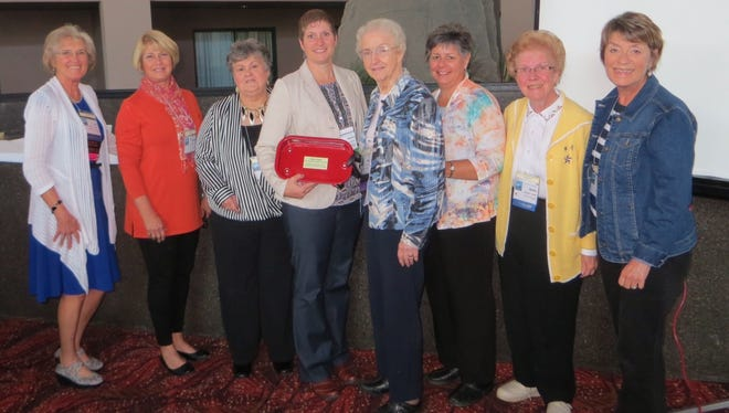 Pictured from left are FAREA member Linda Wilkins, FAREA President Jo Heinkel, Margie Wasmuth, 2014 Wisconsin Teacher of the Year Diana Callope, Mary Heisler, Cheryl Kutcher, Betty Coerber, and Julie Tennie at the 2015 WREA state convention.