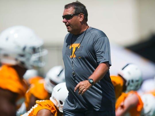 Vols defensive line coach Brady Hoke walks through players during warmups at the first fall practice of the year on Saturday, July 29, 2017.