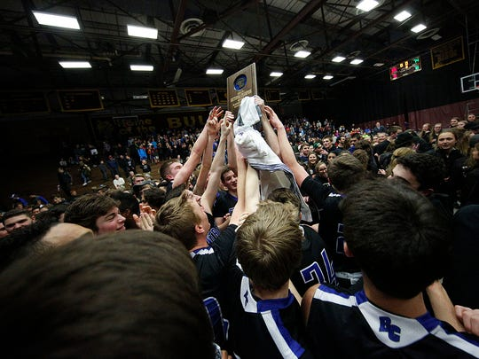 Brookfield Central Players react on the court with their Sectional Championship Trophy following the teams WIAA Sectional Final game against Milwaukee Vincent in West Allis Central High School Saturday, March 11, 2017, in West Allis, Wisconsin. Central won the game and will play in the WIAA State Tournament at 8:15 PM Friday in the UW Madison Kohl Center.
