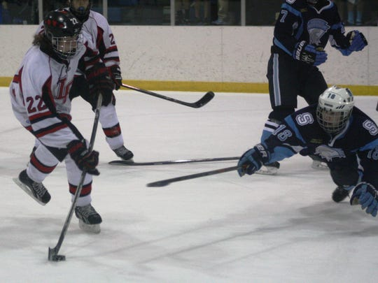 Stevenson's Alex Hunt (18) lays out to stave off a