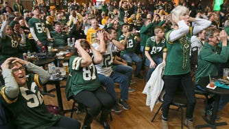 Fans react with dismay to a poor Packers play at an NFC Championship Game viewing party at Turner Hall in Milwaukee.