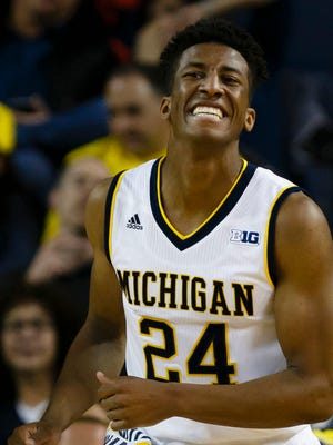 Michigan guard Aubrey Dawkins reacts to a basket in the second half against Northern Michigan  at Crisler Center.