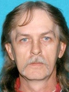 Richard Lee Burton Jr., 47, is a person of interest in Sunday's discovery of three dead in Washington County.