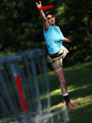 Sarah DeMar of Novi, plays disc golf at an event at Fitzgerald Park in Grand Ledge, Mich., Saturday, June 14, 2008.