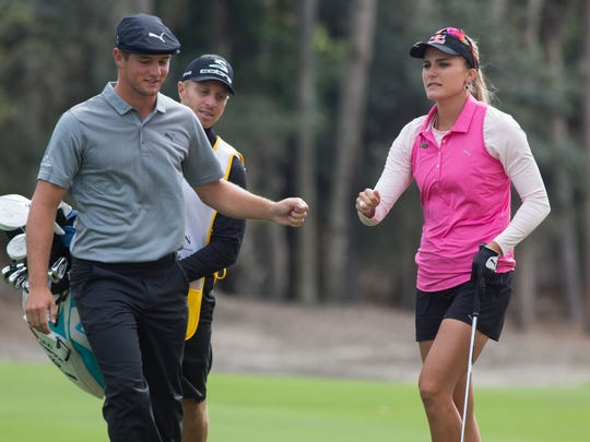 Teammates Bryson DeChambeau, left, and Lexi Thompson bump fists during the second round of the Franklin Templeton Shootout at Tiburón Golf Club at The Ritz-Carlton Golf Resort Friday, Dec. 9, 2016 in Naples. The duo finished the day with a score of 11-under par.