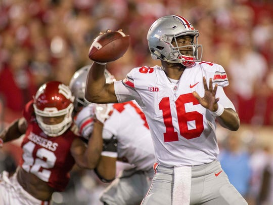 Ohio State quarterback J.T. Barrett threw for three touchdowns and rushed for one in the victory.