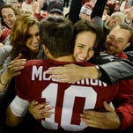 Alabama Crimson Tide quarterback AJ McCarron (10) hugs his mother Dee Dee Bonner (right) and his girlfriend Katherine Webb (left) following their 38-17 victory over the LSU Tigers at Bryant-Denny Stadium.