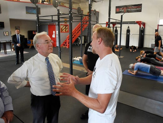 Price talks to Jeff Severston, right, about how the
