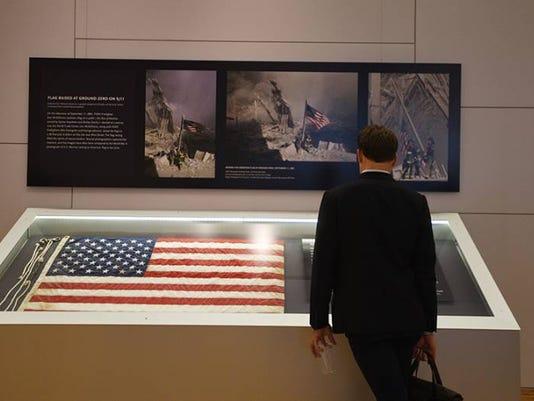 636089396551791031-9-11-museum-iconic-flag-returned.jpg