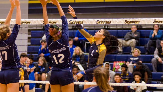 SC4's Kaseka Mulomede (3) pushes the ball over the net during round one of the  NJCAA National Tournament volleyball game against Macomb Community College Nov. 2.
