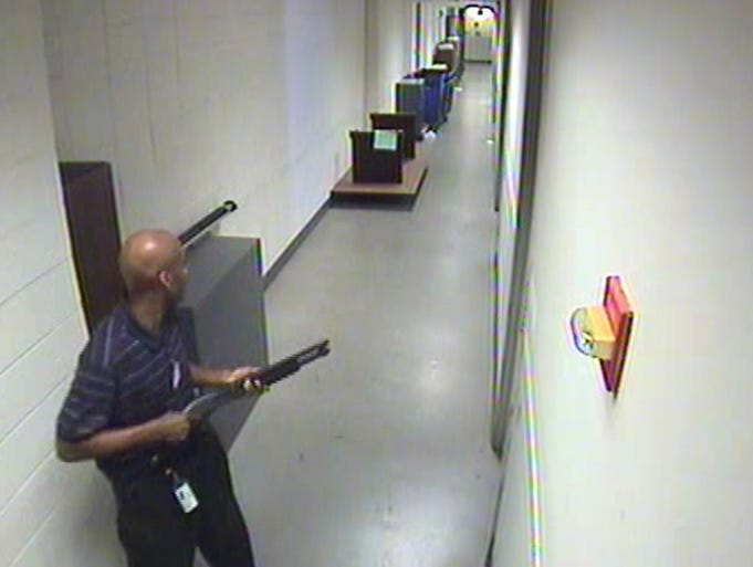 A frame grab from a security camera at the Washington Navy Yard released on Sept. 25 shows alleged gunman Aaron Alexis as he moves through the hallways of Building 197 with his Remington 870 shotgun on Sept. 16 in Washington, D.C. Thirteen people, including the gunman, died in the shooting.