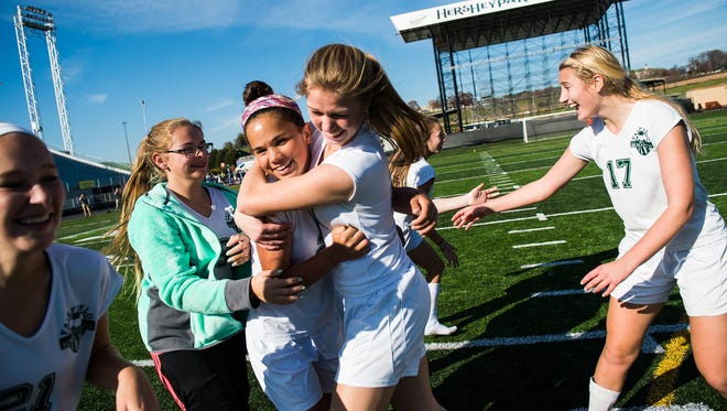 Fairfield's Annabel Anderson is congratulated by teammate Haley Bolin after Fairfield girls' won the PIAA girls' soccer state championship against Shady Side on Friday Nov. 18, 2016 in Hershey.