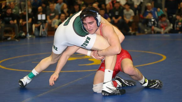 Fox Lane's Matt Grippi defeats Yorktown's Connor Thomas in the 152-pound match at the Section 1, Division 1 wrestling finals at Clarkstown High School South in West Nyack on Sunday, February 11, 2018.