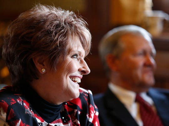 Rep. Linda Upmeyer smiles as her cousin says a few words about her Monday, Jan 11, 2016 as Upmeyer waits to get sworn in as speaker of the house of representatives at the Iowa State Capitol in Des Moines.