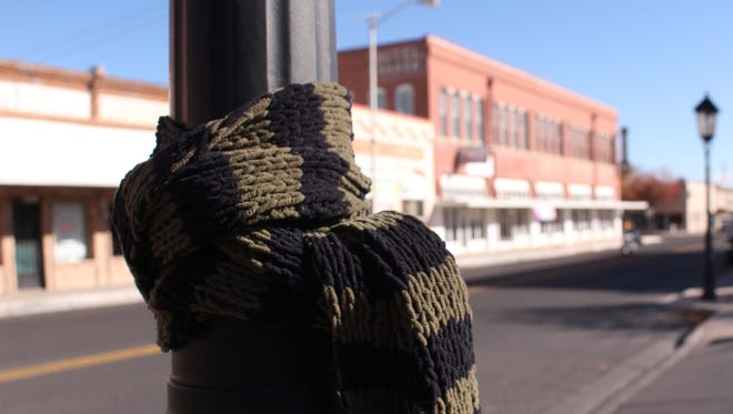 Scarfs and jackets can be seen tied to poles and trees throughout the city. Deming MainStreet Program has joined a nation-wide effort to help the homeless by tying scarfs and jackets around cities for anyone who might need an extra layer of warmth this winter.