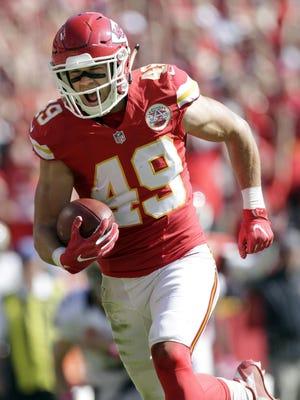 Kansas City Chiefs defensive back Daniel Sorensen (49) runs for a touchdown after intercepting a throw by New Orleans Saints quarterback Drew Brees during the first half of an NFL football game in Kansas City.