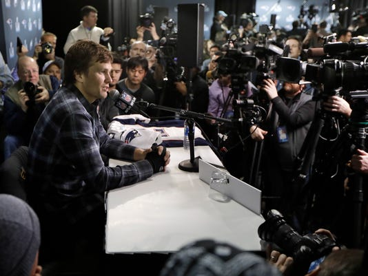 New England Patriots quarterback Tom Brady answers questions during a news conference Thursday, Feb. 1, 2018, in Minneapolis. The Patriots are scheduled to face the Philadelphia Eagles in the NFL Super Bowl 52 football game Sunday, Feb. 4. (AP Photo/Mark Humphrey)