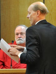 Defense attorney Steve Bjordammen, right, questions Gary Barlow, owner of Texoma Armory and the shooting victim of a November 2015 armed robbery, during the trial of Charles Brandon Johnson.
