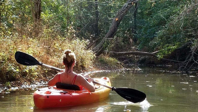Kayaker Diann LoGuidice paddles in Crystal Lake in Oldham County.