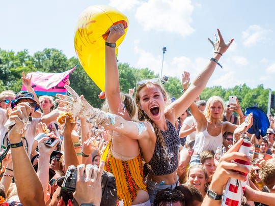 Fans cheer after getting covered in cake by Steve Aoki