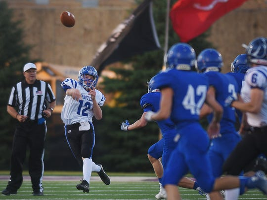 Canton's Scott Peterson completes a pass down the field