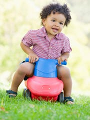 Young boy playing on toy