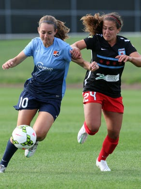 Women's Professional Soccer League game between the SkyBlue FC and the Chicago Red Stars played at Yurcak Field at Rutgers University in Piscataway Sunday June 28,2015. Here SkyBlue # 10 (left)- Katy Freels battles with Red Stars # 24 (right)- Danielle Colaprico during the first half of action.