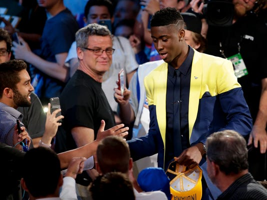 Caris LeVert is congratulated by basketball fans after being selected 20th overall by the Indiana Pacers during the NBA basketball draft, Thursday, June 23, 2016, in New York. (AP Photo/Frank Franklin II)