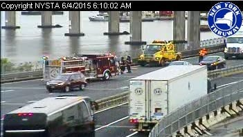 A firetruck arrives on the scene of a vehicle fire at mid-span on the Tappan Zee Bridge, blocking one Westchester-bound lane Thursday, June 4, 2015.