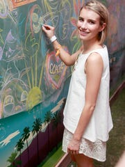 "Actress Emma Roberts shared her ""it's all good"" moment on a chalk wall at the Fruttare Hangout at Coachella on April 11, 2014 in Indio, California."