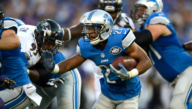 Lions running back Ameer Abdullah rushes the ball in the first half of a 2016 preseason game against the Baltimore Ravens.
