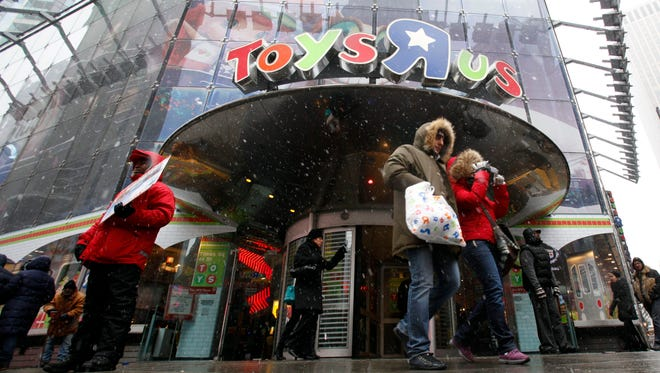 Shoppers leave the ToysÒRÓUs store in New York's Times Square on Dec. 26, 2010.