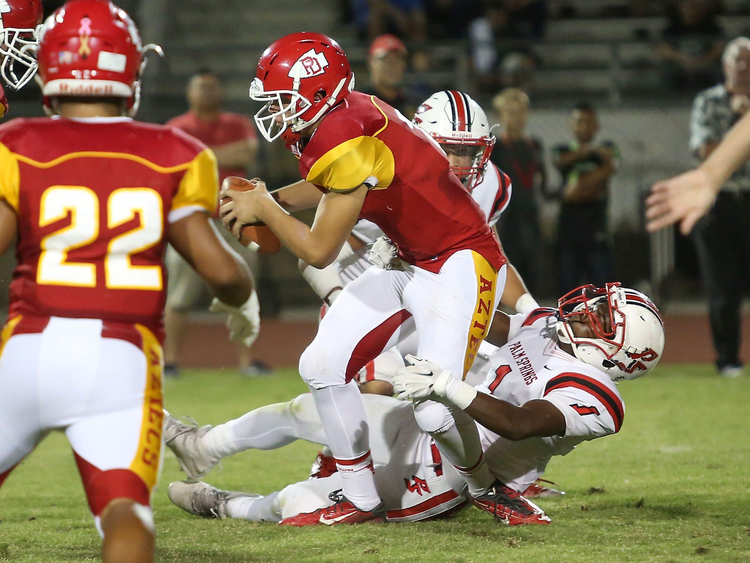 Dameon Stovall-Price, 1, of Palm Springs sacks the Palm Desert quarterback, Oct. 14, 2016.